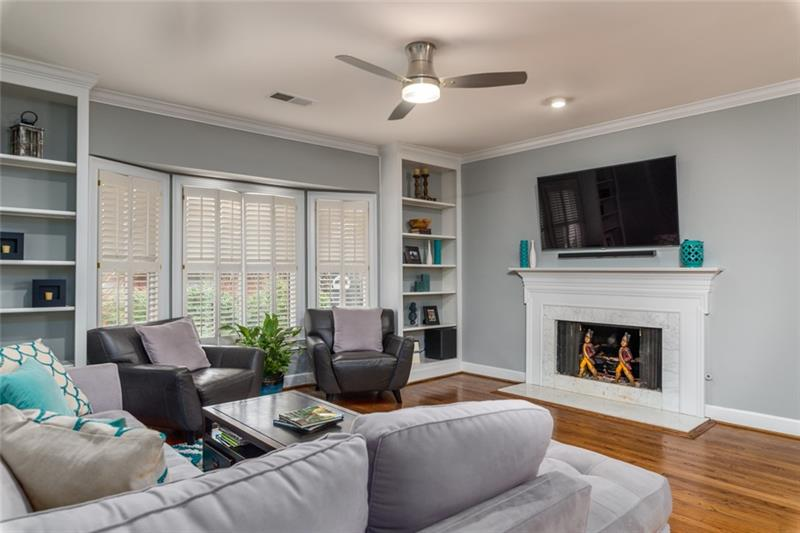 Beautiful marble fireplace is the perfect accent to the family/great room!