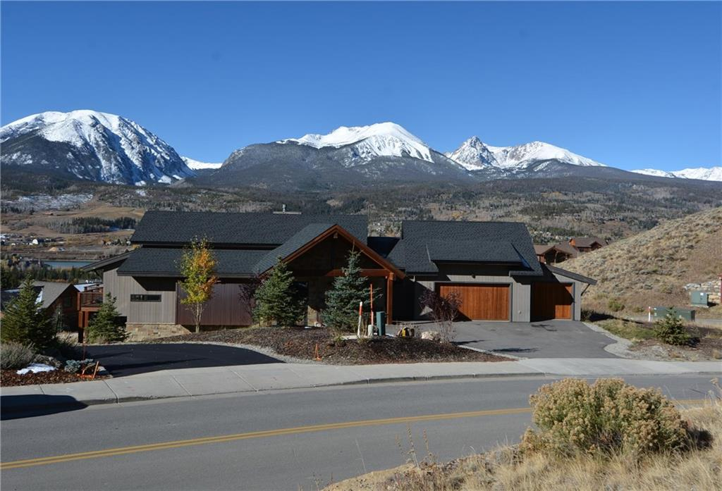 Most impressive custom built home in Angler Mountain Ranch.  Soaring windows capture exceptional views.  Gourmet kitchen, dining and living area opens to South and West facing deck, perfect for entertaining.  Main level master suite, huge master bath and walk in closet.  Lower level features family room, media room, and walkout patio.  Three car garage.  A stunning home!