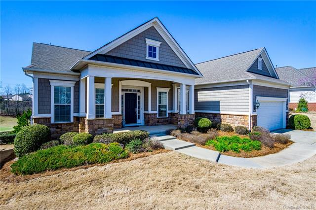 Beautiful Bluffton home with GOLF COURSE views in over 55 neighborhood. Eat-in gourmet kitchen with granite, upgraded cabinets, lots of storage and counter space.   Large bright sun room overlooks the golf course. Living room with gas fireplace and built-ins. Office and formal dining room. Two bedrooms on main level.  Custom closet in master. Downstairs completely finished basement offers large rec room, walkout patio, bedroom, bathroom and extra room. Neighborhood offers so many amenities such as Sidewalks, Jogging, Fitness Center, Pond, Pool, Golf, Tennis, Clubs & more. Enjoy the resort lifestyle!