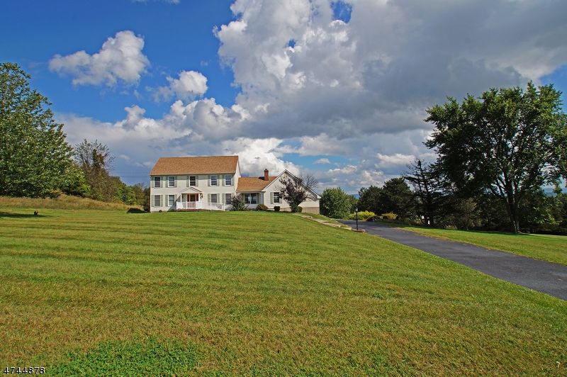 You'll be loving life from your mountain top perch!  Ever-changing panoramic mountain views transport you to a place of utter contentment.This expansive custom colonial offers a place for everyone--