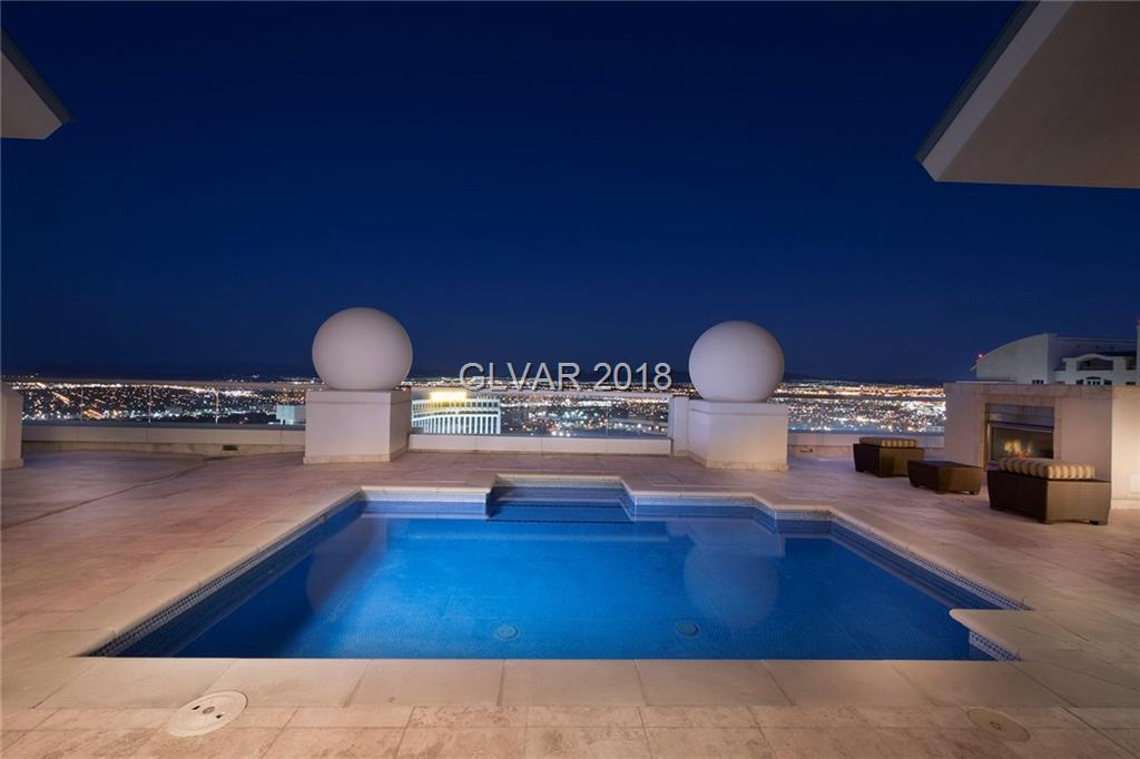 One of a kind custom 2 level Top floor penthouse showcasing 270 degrees of majestic view of the world's famous LV strip,mountains & 2 golf courses.Unique 6,421 sq.ft.Top floor features a private pool, spa,massive upper deck dbl fireplace,2 wet bars, game lounge,spacious living room opening up to the gourmet kitchen, formal dining,3 large bedrooms w/room for more,5 baths & 3 verandas.Walk to the best entertainment,shops & dining. Limo services+