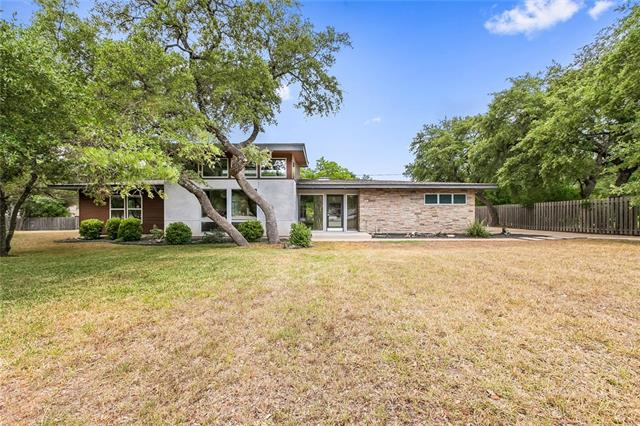 "AMAZING CONTEMPORARY home on a wooded approx. 1/3 acre lot in Old Lakeway. 2010 ""Down-to-the-slab"" remodel of a Mid-Century Modern.   High end finishes include abundant Walnut cabinetry, Quartz Countertops, Thermador Appliances, CAT 5 wiring, and more.  In-law plan with 3 large bedrooms, 2 full baths and powder room, and study. Master Bath features large tile shower, garden tub, and custom closet.  STUNNING ONE-OF-A-KIND CUSTOM HOME."