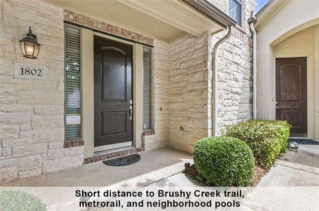 Tucked away in a quiet section of The Greens at Avery Ranch is this turnkey move in ready condo. Located in the back of the community with a greenbelt view. This is the best location in the neighborhood with green space adjacent to the home and close to the path leading to 10 rated Rutledge Elementary, neighborhood pool and Brushy Creek Trailhead. Ownership of this home provides access to Avery Ranch amenities...5 pools, tennis courts, playgrounds. Upgraded custom master closet. 2 car rear access garage.