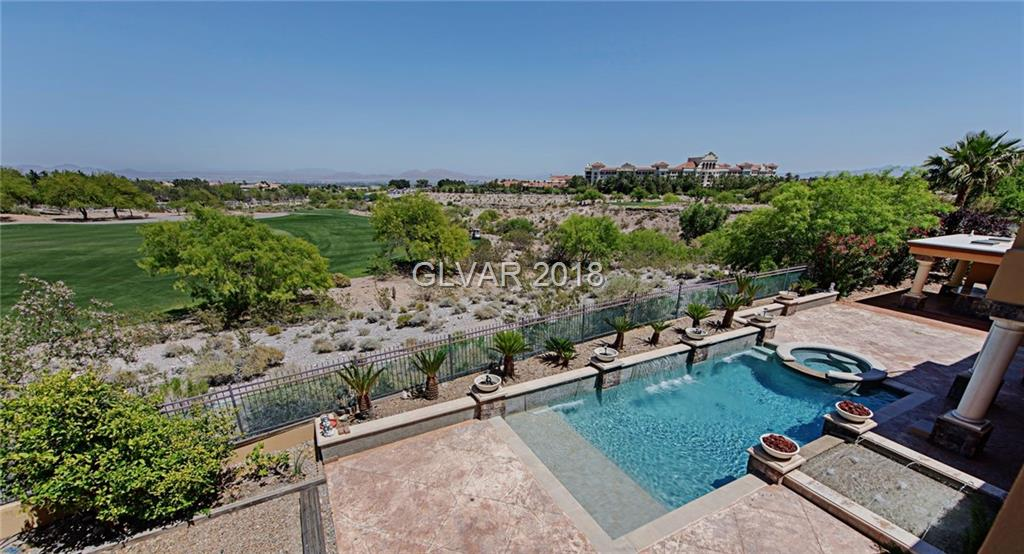 8,541SF luxury home w/gated courtyard entry w/FP, stacked stone & water feature. Interior w/vaulted ceilings, elevator, formal living & dining rms, 2 extremely large masters (up & down) w/large balcony w/stunning golf & Strip views, jacuzzi tub, rain shower, morning breakfast. downstairs maid's qtr w/separate entrance from courtyard. Additional maid's qtr & in-law suite upstairs w/separate stair entrance from couryard.  Gorgeous gourmet kitch w/