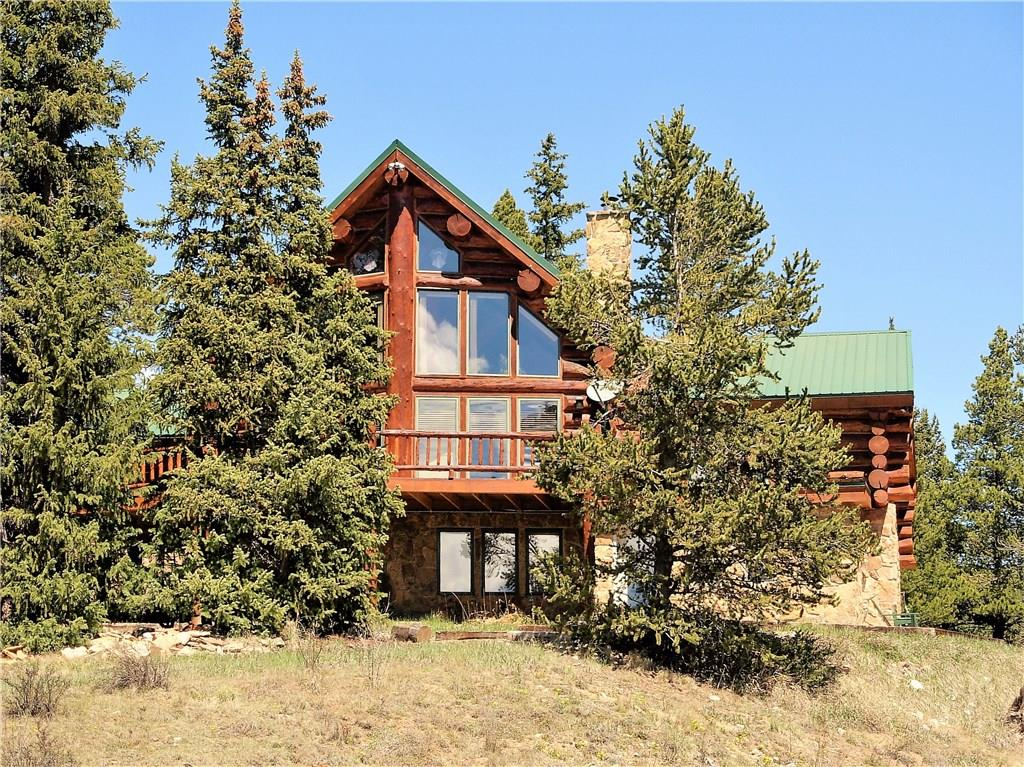 PRICE REDUCED AGAIN!! Fully furnished full round log home sits only 15 mins to Breck on 10.23 ac with fishing ponds and the Middle Fork of the South Platte River on the property. Features in-floor radiant heat, slab granite countertops, SS appliances, 2 story real stone gas fireplace, main floor master suite with 5 piece bath and knotty pine doors throughout. Family room features a wet bar, pool table and enclosed hot tub room. OS 2 car detached garage PLUS add'l 2 car garage and paved driveway.