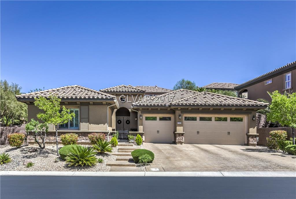 Stunning, Highly Upgraded, One Story, Pool/Spa Home, Located in Guard Gated Club @ Madeira. This exquisite home features open great rm floor plan w/ romantic fireplace, designer chef's kitchen,  breakfast area, upgraded cabinets, granite, tile, butler pantry, custom paint, travertine baths, formal dining, huge master bed & bath w/ jetted tub, closet w/ built-ins, central vac, water softener,  2x6 construction, relaxing tropical like backyard.