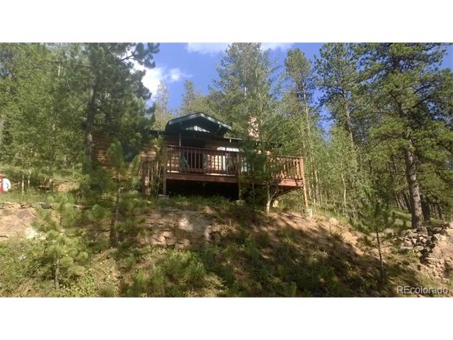 Adorable, original log cabin with beautiful views from the front deck and swing up above! Hear the stream below from the front deck! Beautiful pine and aspen trees. Wildlife everywhere!  Completely restored inside and out - laminate wood floors, new kitchen and bath; logs sanded, stained and chinked. Outdoor fireplace with lots of character.  This is a great week-end get-a-way location with access to two stocked lakes and pond. Potluck and Bingo in the community center all summer. National forest is just down the street. Great area for leisure, for tents and/or a storage shed. 500 gallon water tank and septic holding tank.  A must see!
