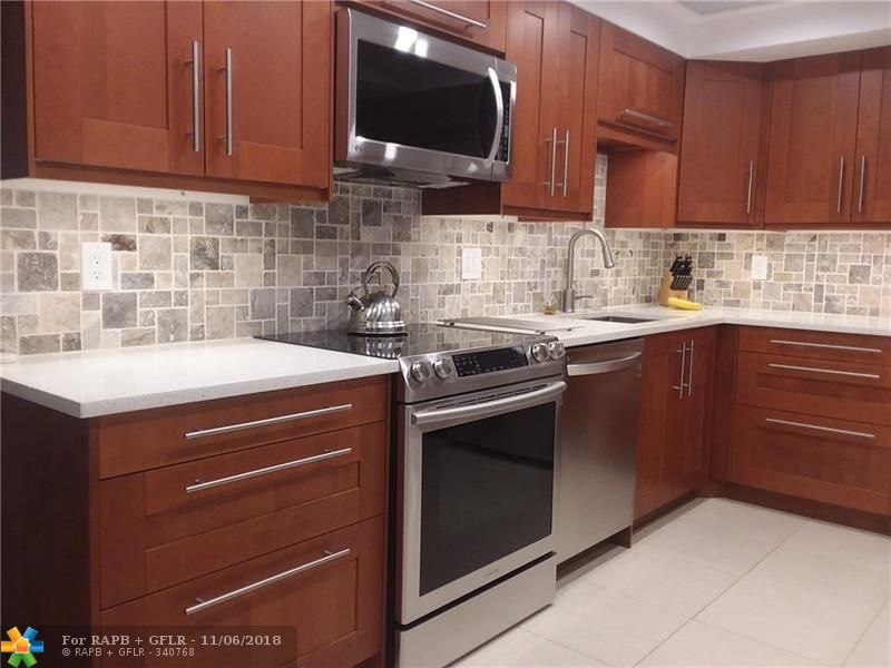 True 3 bed 2.5 bath unit with spectacular wide lake views. No carpet, no wallpaper, no mirrors, no popcorn ceilings.  All new CGI impact windows and 4 panel slider. This condo boasts traditional finishes with modern touches for a timeless design. All windows have brand new plantation shutters for full privacy; LED lighting throughout; huge living room with shiplap accent wall. Kitchen has quartz counters and brand new SS energy star appliances. Full size laundry in unit. Bldg was just painted and has good reserves. Low HOA includes cable!