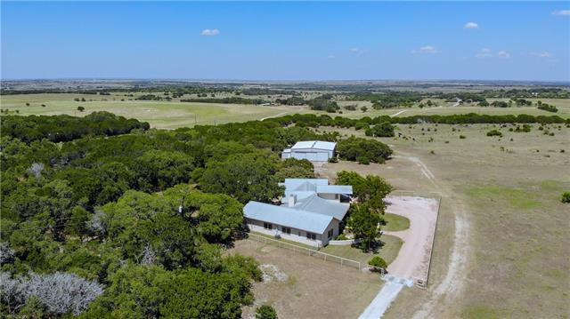 Custom home, 3 grass runways & airplane hangar.  One hour from Austin.Home: Built w/ Rastra, insulated concrete building system, for energy efficiency.  Has crows nest (air traffic control).Hangar: 2,040 Sq. Ft. w/ 1BR/1BA apartment w/ full kitchen.Airport: registered private airport w/ FAA. Runways: 13/31 is 2000'x50'. 17/35 is 1375'x 50'. Cross wind runway - 1000' x 50'. Water: Well & 10,000 gallon rain water collection system.Texas Hill County - 50 acres covered in large oak trees.