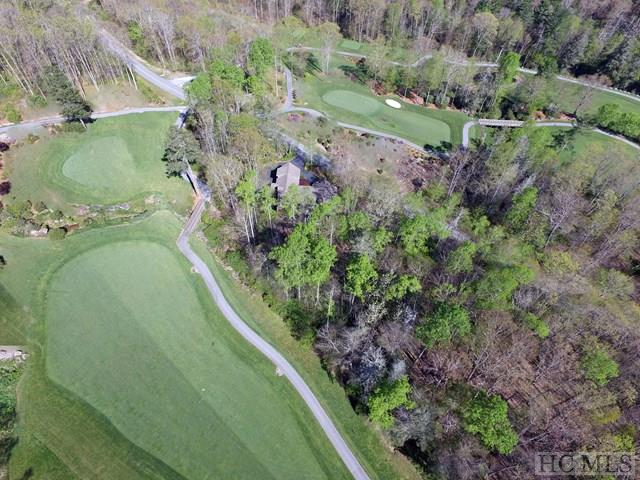 This easy to build home site offers the buyer the opportunity to customize their back deck to take full advantage of the view of the 12th fairway/green on the Old Edwards Club Golf Course! Depending on the build, this lot offers the possibility of a winter view of Shortoff Mountain. Great location within Old Edwards Club @ Highlands Cove, is nestled in the long the back nine of the course and has a wonderful stream on the property line.