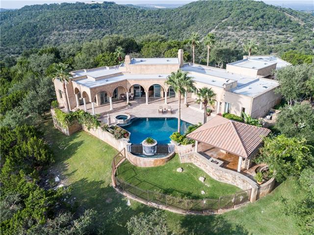 Magnificent 25 ac. private gated estate is on one of the highest points in Lakeway. Rare single story. Breathtaking panoramic views of Hill Country and nearby Lake Travis. Surrounded by beautifully landscaped grounds, resort style pool, outdoor summer kitchen and fire pit. Guest house & Wine Room. The open floor plan & attention to detail in every room exudes near perfection! High-end appliances, stone floors throughout living areas, kitchen & office. Close to Hill Country Galleria shopping & restaurants.