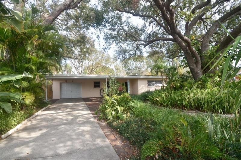 Welcome to this private oasis located in Delightful Dunedin.  This wonderful two bedroom home is literally steps away from The Hammock, Highlander Park & Aquatic Complex and just a short bike ride on the Pinellas Trail to down town Dunedin and Honeymoon Island.  The Dunedin Fine Arts and Community Center are just around the corner as well.  This great home features terrazzo flooring throughout, massive closet space and many tasteful updates like louvered closet doors, Corian countertops and new vanity top and sink in main bath.  Step out any of the french doors and you will find brick patios that lead to the lush and tropical backyard.  Garage has been freshly painted.  Wall a/c units are newer and roof was installed in 2011.  Come see!