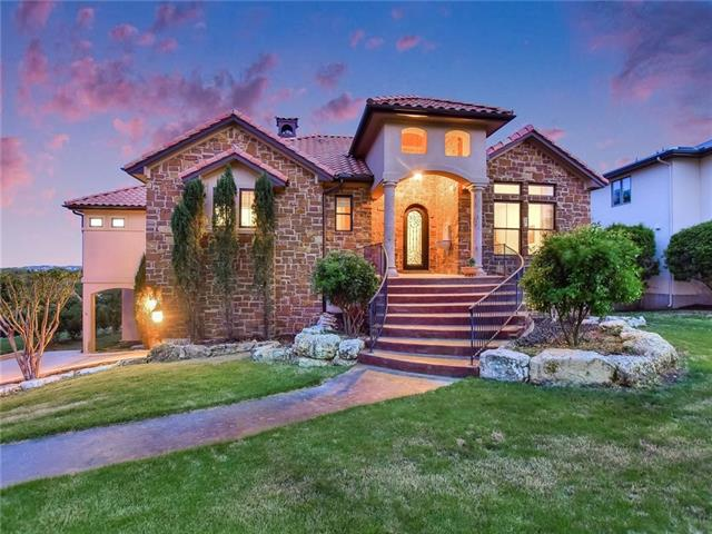 This Mediterranean, custom home is located on a waterfront cove hillside, nestled on just over 1.4 acres, within a gated community. Completed in 2010, this 2 story home has expansive views, from the upper and lower covered patios and many of  the interior, lake facing rooms. This original owner, had great passion in the design and the quality, of it's construction. The floor plan is available and a preliminary pool design. The community marina has boat slips for lease, subject to availability.