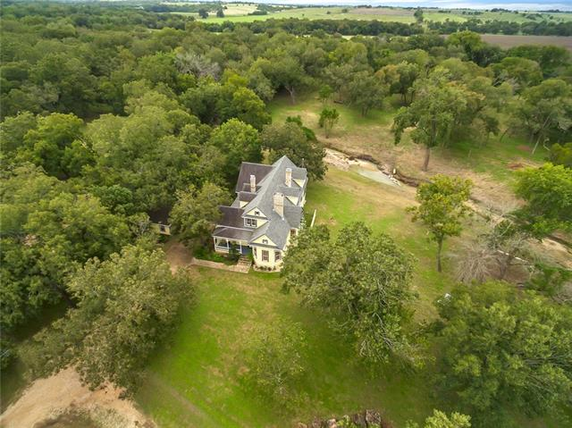 Own a piece of TX history with this 22 acre ranch +1890s Princess Anne style home. See MLS 3519569 for home details. Cottonwood Creek runs thru the property, Brushy Creek abuts further south. Outbuildings include guest home in need of remodel, former dairy barn/storage area, shed w/ water softening system, mosquito/misting system, one of three wells, + carport. Cabana + outdoor spaces ideal for entertainment & recreation. Potential as event venue, B&B or multiple building development. 30 mi from DT Austin