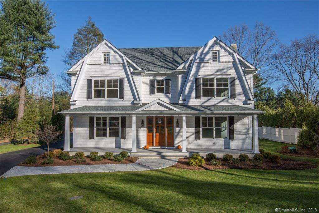 """This two year old 5 Bedroom, 6 Bath Nantucket Colonial style home exudes workmanship perfection from the 9 foot coffered and tray ceilings down to the 4 inch white oak floors and light filled spaciousness. Every inch of construction is with high end materials and finishings, and no detail was overlooked in this move-in ready masterpiece. This home generously boasts five oversized bedrooms with all but one having an ensuite, each one more stunning than the next with their soothing color schemes. Five full baths and laundry room are located on upper level with half bath on main level. Master Bath with heated floor. Gourmet kitchen amenities include full granite, and plenty of desirable solid wood white cabinets in the kitchen. Only the best appliance names can be found in this space to ensure a quality cooking experience for you and your guests as you entertain them in this open floor layout. If that wasn't enough, the flexible space bonus room above the garage is perfect for your own exercise room, retreat or even home office. Walk up attic offers potential 3rd floor finished space. Desirable level and fenced in yard with an Entertainer's Oasis featuring granite stone patio, outdoor kitchen with top of the line appliances and 65"""" outdoor TV. With all the attention to detail done for you, there's no need to hesitate on making this your next move."""