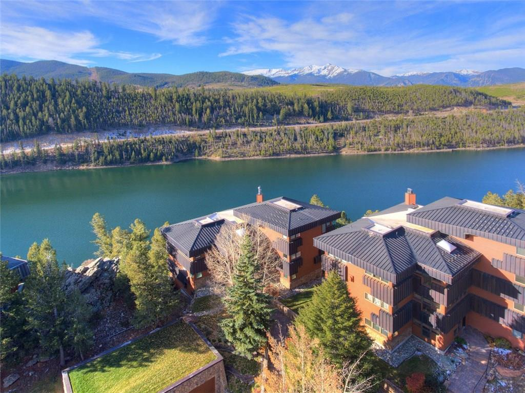 Perched on the granite cliff, in the sought-after area of Summerwood, this is a glorious spot with views you won't want to leave. The majesty of mountains, lake & sky…what joy.  The condo lives like a house, all one level w/open floor plan, big windows, huge wrap-around deck over the water and a few minutes from Keystone Ski Resort. Clubhouse w/ tennis, fitness, pool, hot tub. Enjoy the best views Summit County can offer. See full photo tour link.