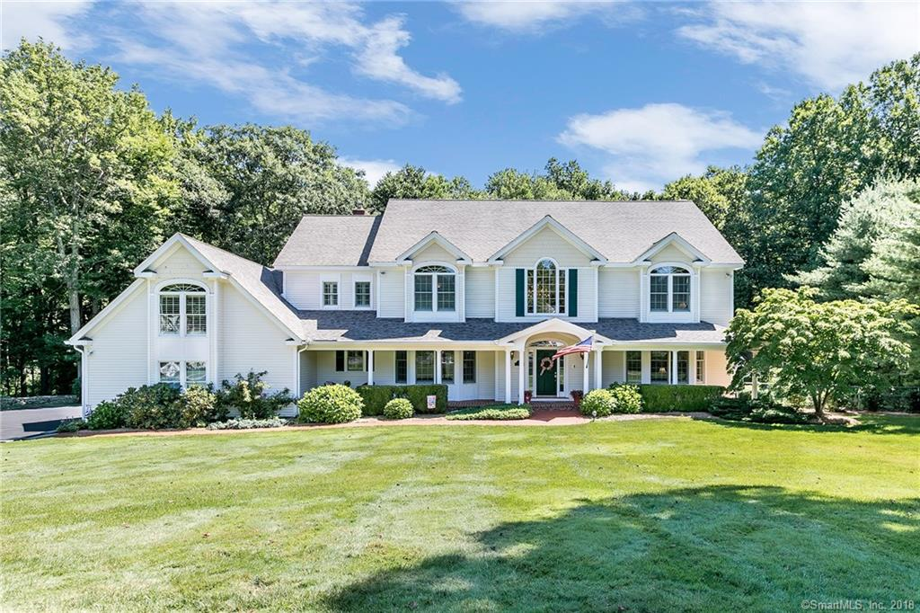 """The jewel of this premier central Monroe neighborhood sits serenely at the end of the cul-de-sac, on a flat 1.43 acres offering a gracious welcome to all. As you enter, you are greeted by a sweep of grand staircase filling the 2-story foyer. Light filled formal living and dining spaces flank the entry while deep crown molding and wainscot lead you to the open flow kitchen and sunken great room. What perfect entertainment/family gathering space! Custom cabinetry, and built in gourmet appliances beckon from the chef's kitchen while comfy seating space and built in entertainment units bid you sit a while in the great room. Beyond the kitchen a Trex deck and patio, and inviting sun room. """"Nest"""" thermostats and doorbell/camera, Laundry room and powder room near by make life easy. Up the back stair, the """"mezzanine"""" level offers a wood paneled office fit for a king with gas fireplace and custom mill work detailing built in bookshelves and storage. An expansive bonus/bed room next door is accessed through lovely french doors and offers many possibilities. Elegance is defined in the Master Suite by cathedral ceiling, palladian windows, window seat, his/hers walk-in closets and marble master bath with double vanities, whirlpool tub and separate shower. Other bedrooms on this level offer jack-n-jill bathrooms. Off the kitchen, a FOUR car, open garage! Home has whole house speakers and is in fabulous condition... Come visit today! (PLEASE SEE PUBLIC REMARKS ADD)"""
