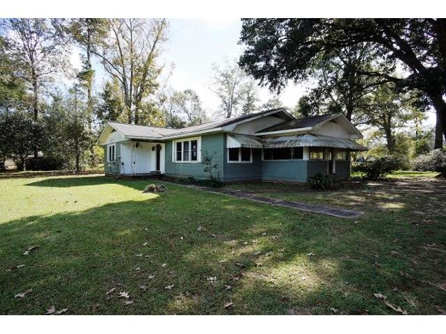 Beautiful 2 acre home site with raised cottage and detached single car garage. Large living room, enclosed sun room and island kitchen.  Original hardwood floors in living room and bedrooms. Bathtub has been updated, home has central air and washer and dryer are indoors.