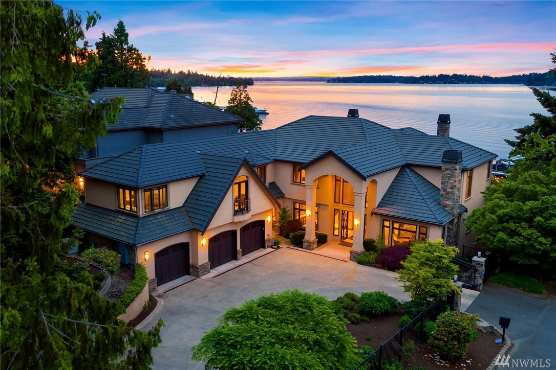 Your waterfront story begins here. Expertly built in 2007 & perfectly sited on half an acre & 83' of coveted north facing waterfront.  Your guests are greeted by a gracious gated entry and a stunning Chihuly chandelier. Soak up the view from the great room & expansive outdoor spaces and infinity pool. The spacious view master suite is a true retreat. The lower level offers 1000 bottle wine cellar plus media/game room. The dock will moor a large yacht & smaller boats/jet skis. Live at the Lake!