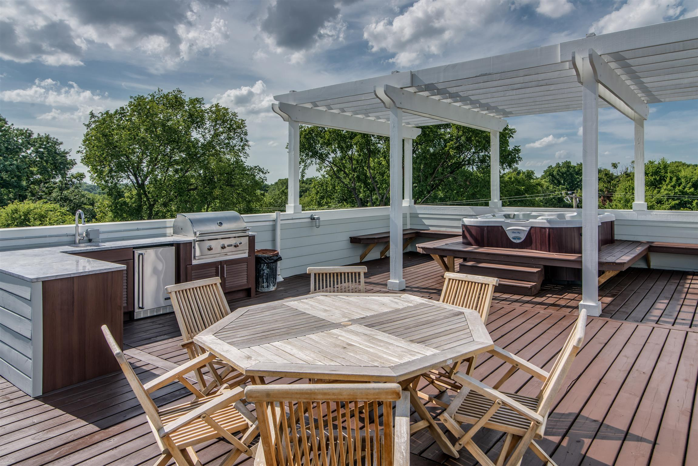 AMAZING view of downtown, hot tub, grill, and firepit on rooftop deck. Wrap around porches, Savant surround sound on all floors, corner lot, fully fenced-in yards,  3 car garage. 2200 sq ft of outdoor deck space! Security system, NEST thermostats, 4 bed / 4 bath, game room, 2 fireplaces, body sprayers in master bath, huge master closet.