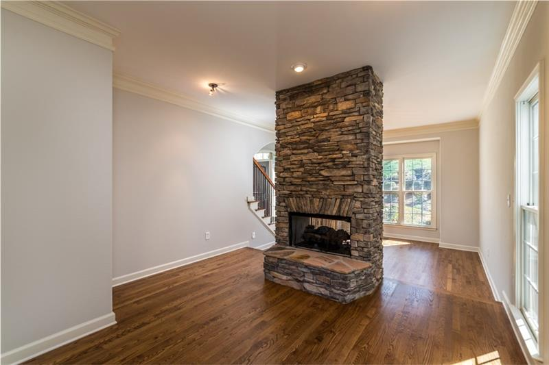 Truly gorgeous 2 sided fireplace gives an inviting feel to the breakfast area/kitchen & the formal dining room!