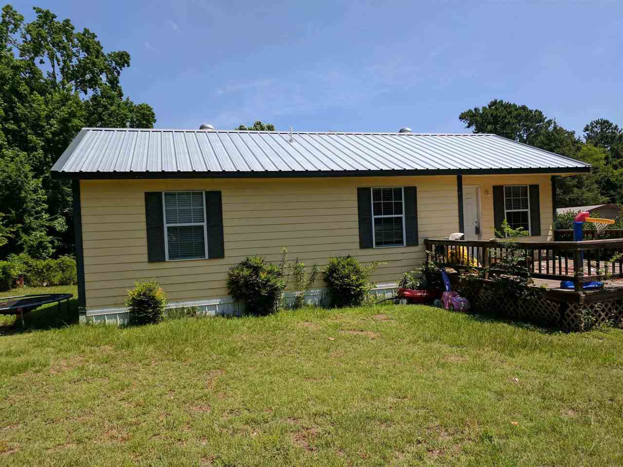 Great starter home, investment property, or retirement spot in Gilmer on 1 ACRE!! Cute and Charming 3 bedroom 2 bath home with nice vinyl flooring, large deck out front perfect for relaxing with the family or enjoying your evenings outside, great kitchen counters w/modern looking backsplash, metal roof, and more! Won't Last Long!