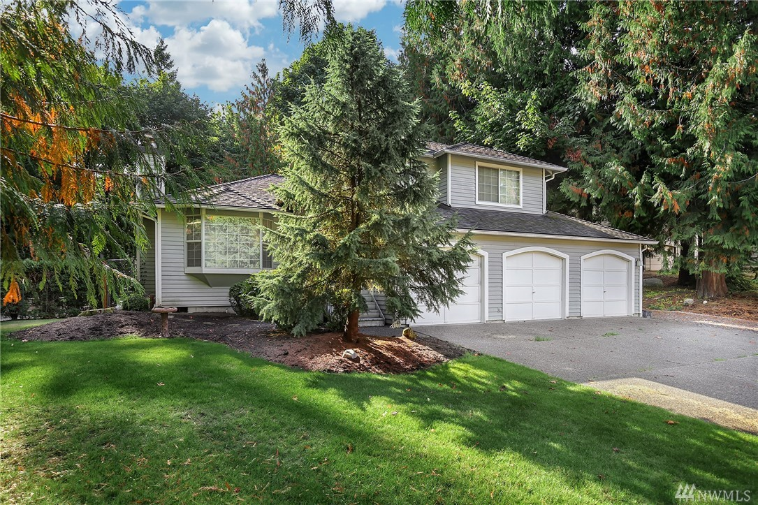 Gorgeous updated tri-level near Ames Lake/Redmond. Inspiring updated chef's kitchen w/ granite countertops, subway tile backsplash & HW floors w/ kitchen nook & slider opening to entertainment-sized deck. Fenced backyard surrounded by oversized lot landscaped w/ relaxing Koi pond & lots of color & beauty to enjoy. Entertain in formal LR flanked by gas FP or relax in lower level FR w/ FP. 3 generous sized bedrooms & 2 full baths. Sport Court, RV Parking, wired for generator, 3 car garage.