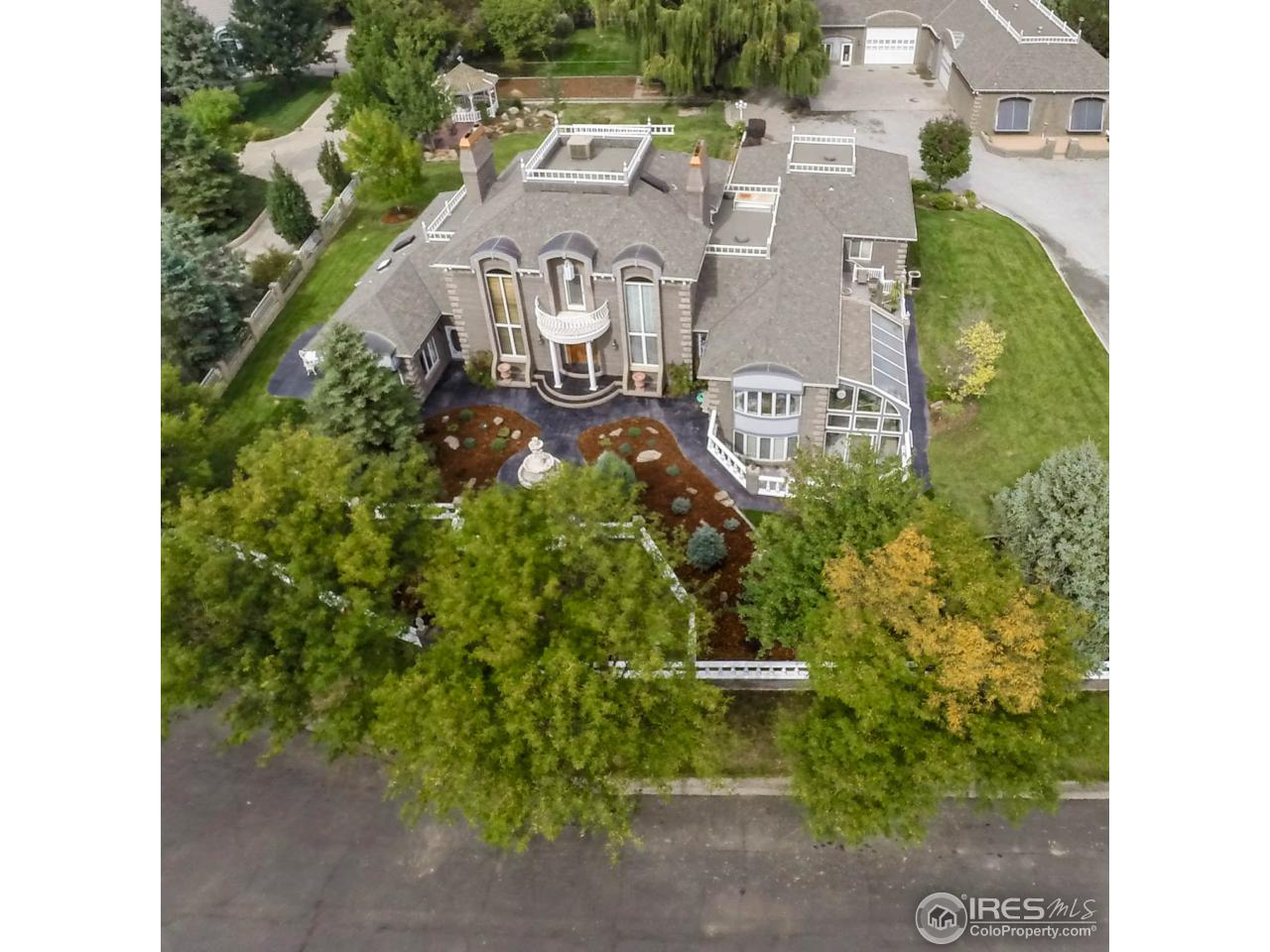 Gorgeous French Provincial Estate w/shop, offices &/or carriage house. Well thought out living areas w/marble & wood floors, beautiful European elegance & the finest craftsmanship throughout. 4+ fplcs, energy efficient heat sources. Landscape & grounds are immaculate. Shop is 6000+ SF w/paint booth, car hoist & 800 SF structure for add'l storage. Home & improvements have been lovingly maintained by builder/original owner. Irrigation from Seeley Lake at add'l cost & boating membership required.