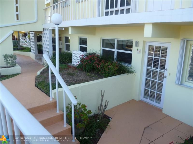 Three story Condo Building , on the Sand and Ground Floor unit with private patio. Unit is Beautifully Updated Kitchen and Bath, warm furnishing's. Ocean and Intercoastal views on World famous Hillsboro Mile. Available for annual rental start December 2017