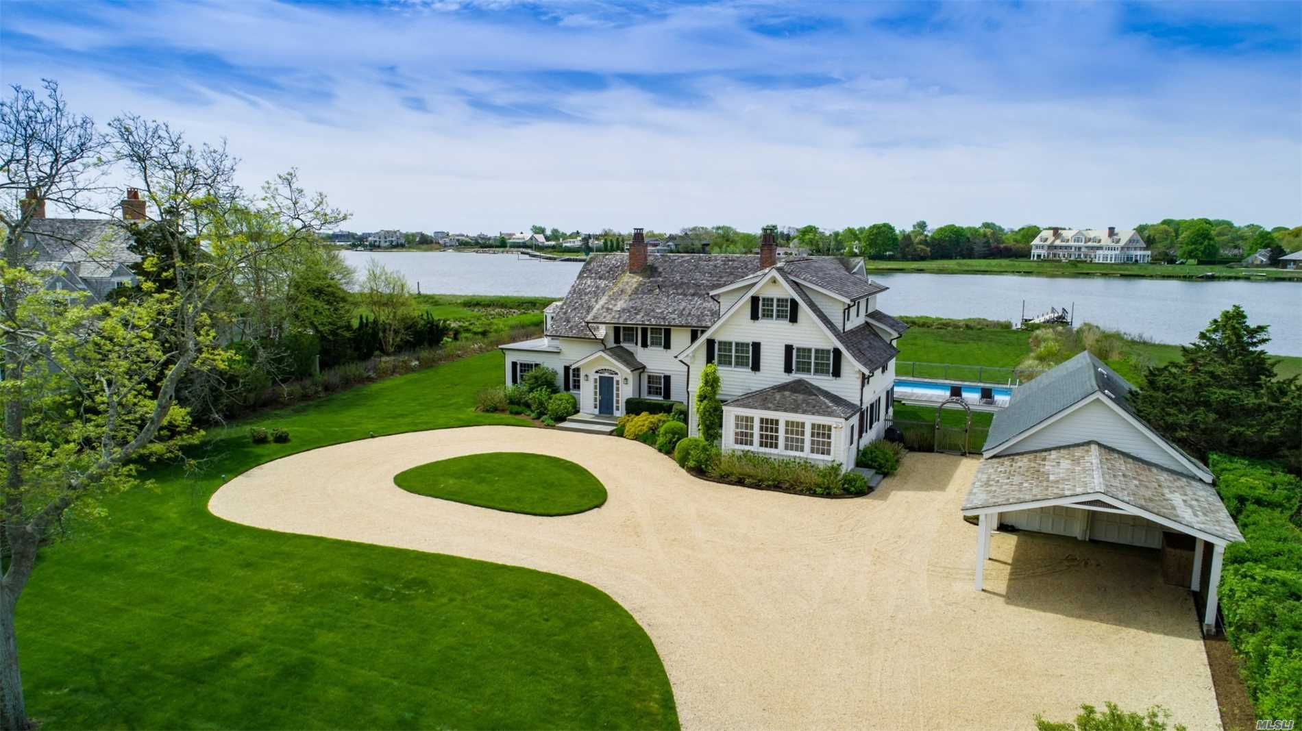 This Beautifully Renovated Traditional Hamptons Waterfront Home Is Now Available. Located In The Desirable Quiogue Area Of Westhapton, This Home Boasts Endless Water Views And Glorious Sunsets The 1.5 Acre Estate Has Been Meticulously Renovated To Preserve The Original, Classic Design Details, Updated To Accommodate Today's Lifestyles. Heated Pool, Detached Garage And Floating Dock.