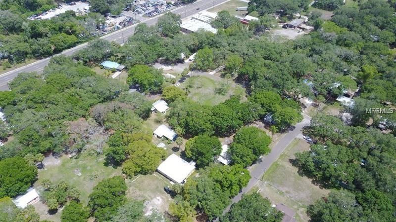 Charming & Peaceful Mobile Home Park in a Terrific Location- in the Palm River Area.  Sale consists of a total of 3 parcels; 7 Trailers, 1 Mobile Home, 1 Block Home, and a Garage.  There is plenty of room for Redevelopment as Property sits on a total of Approx. 5+ acres.  This is an Investor's dream!  Located just off 50th Street; Property has a Great Country Feel with Causeway Blvd and Selmon Expressway Convenience.  Arrive in either Tampa or Brandon within 20-30 minutes.  Limitless Potential!   HIGHLIGHTS: • Potential to be an Excellent Income Producer!   • Seller Motivated for a Quick Closing • 7 Trailers, 1 Mobile Home, 1 Block Home, and 1 Garage • Plenty of lot space to develop! • Shops and Restaurants within minutes away • Causeway Blvd and Selmon Expressway in close proximity