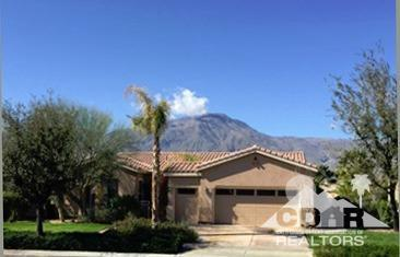 Overlooking the 10th green and fairway at Trilogy La Quinta - a 55+ community. This Cassius model features an open and spacious floor plan with an extended rear patio cover enhancing the shade. Lounge by the pool and view the golf course and Santa Rosa Mountain range. Trilolgy has an 18-hole championship golf course, tennis, pickleball, bocce, 2 clubhouses, 2 pools, full gym, various arts/crafts and fitness classes, theater, day spa, and cafe. Low HOA fees.