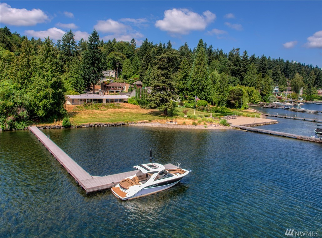 WOW! Rare Opportunity to own 173 ft, NO-Bank Waterfront w/ Expansive Lake Washington Views! Revive existing 4BR Mid-Century Modern, or Build NEW Prestigious Properties! 1+ Level Acre of PRIME LAND, Subdividable Property. Water-ski from your upgraded Dock, Entertain on your Yacht, or Stargaze on Private Sandy Beach. SPECTACULAR VIEWS of Bellevue, VMAC (Seahawks camp), & Mt. Rainier. Quiet Island living close to everything Seattle & Bellevue have to offer! Buyer to verify ALL Info ~ Sold As-Is.