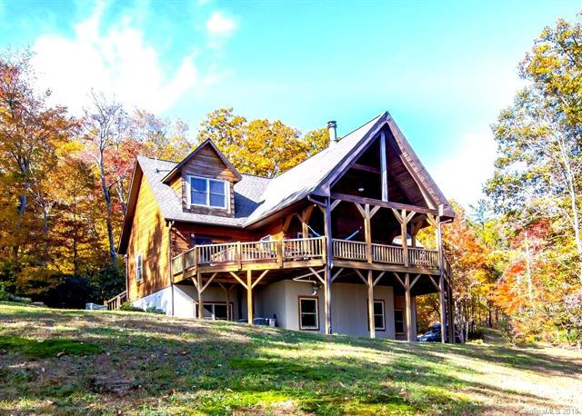 Just Reduced, Motivated Seller. Come home to 3,000 ft elevation with an incredible view. Beautiful 4 BR / 3.5 BA Southland log home. Upgraded kitchen with quartz counter tops and stainless steel appliances, large dining room and breakfast bar. Master on the main level, cathedral ceilings, hardwood floors and so much more. Oversize deck with hot tub is perfect for entertaining. Quiet and private community with hiking trails and waterfalls. Basement could potentially be modified into Guest Suite with a private entrance. Neighborhood also allows for rental properties, otherwise a great year-round home. Previously managed by Carolina Mornings as a short term vacation rental.