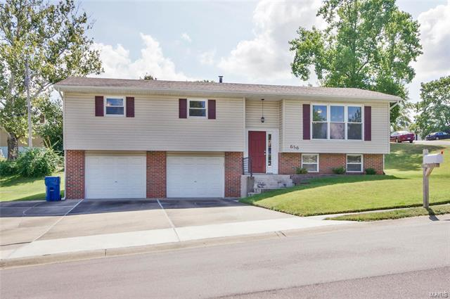 First showings Saturday October 6th, 2018! Fantastic Opportunity to own this move in ready updated 3 bedroom/2 bath home in St. Charles. This home offers an open floor plan, gorgeous hardwood floors throughout (2014), updated baths, large bedrooms with newer carpet (2015/2016), new water heater (2017), and an updated kitchen! The spacious kitchen offers lots of counter space and cabinets, double sink, as well as newer stainless steel appliances (2017). You will absolutely love the finished basement space, the perfect place to entertain and relax! This home is located near local shops, restaurants, and so much more! Schedule your private showing, as this property won't last long!!!