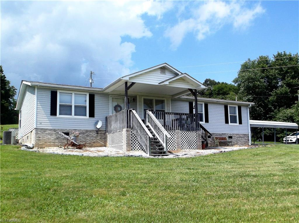 Under Tax Value! Looking for a place w/a peaceful, country setting, here it is! 3BR/2BA on 1.65 acres, open floor plan in kit/din/living rm area,kitchen has pantry, lots of cabinets & counter space,eat-at bar area,stove, refrig, microwave will stay,free standing fireplace in liv rm to stay, lg laundry rm w/shelf, master suite w/garden tub & separate shower in bath,nice size bonus rm for office or playrm,covered front porch, huge back deck,lg wd stor building,2 car detached carport,Broker is owner. AS/IS.