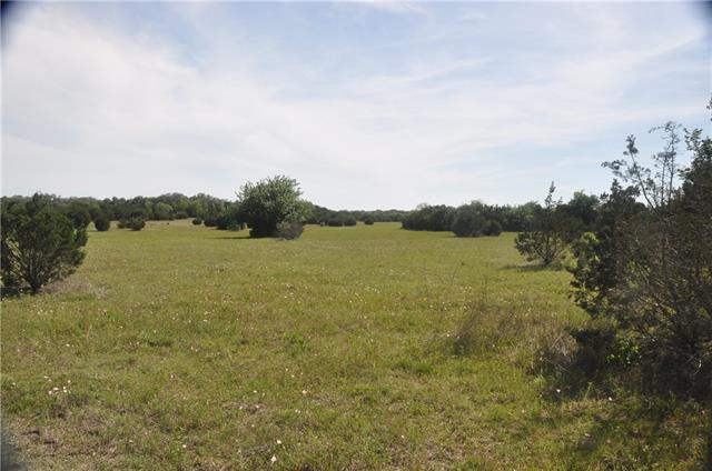 26+ ac rolling pasture with beautiful views. Property is two tracts combined and includes 2 Grand ranch style entry with custom gate with steel art design selected by purchaser. (Red gate is temporary) Includes fencing on perimerter and cross fence between. Buy now - Build later. Ag exempt.  Georgetown water on property.  The Ranches of Salado Brook is lightly restricted. Owner/Broker