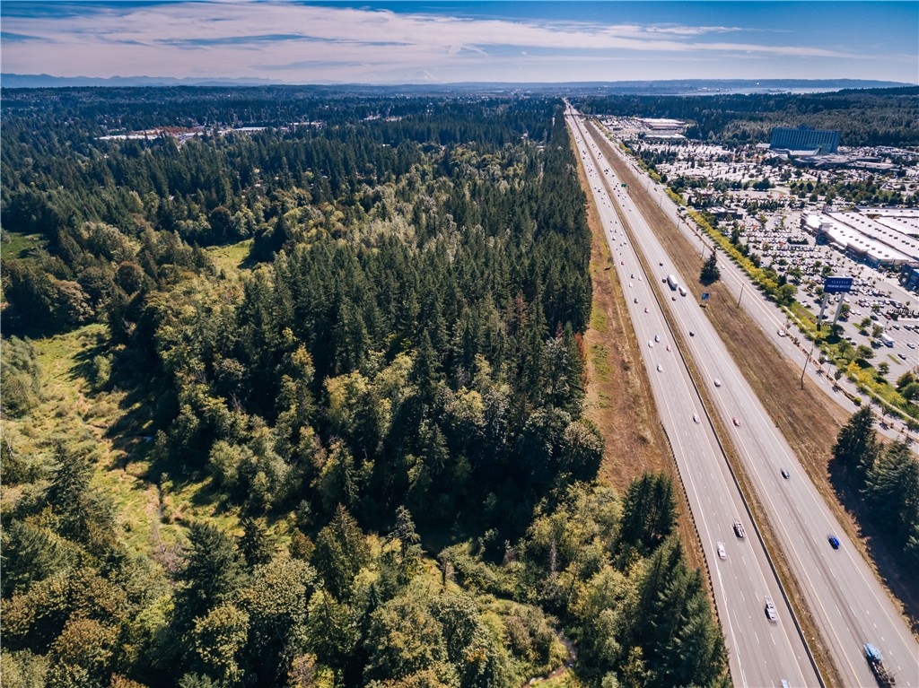 Over 18 acres of Interstate 5 Frontage for Sale across from Tulalip Resort & Casino and Seattle Premium Outlet Mall! Unique piece of property with no comparison. Mature timber resource (about 12 loads), access from 88th Street off I-5, potential future access to properties off 116th Street. Borders Multi-Family zoning. Will look at all offers. Connecting properties also for sale.