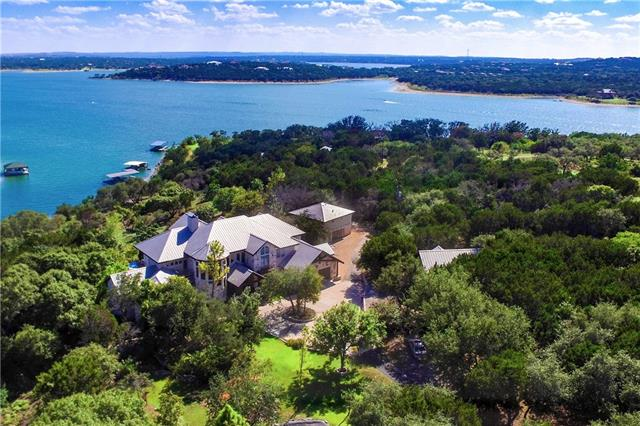 Incredibly private estate on Lake Travis! 40 acres on deep water with incredible, big lake views. A wooded, winding drive takes you to the lodge style luxury home featuring an attached guest apt, enormous great room with towering cedar-beamed cathedral ceilings, floor to ceiling windows and gourmet kitchen. The custom pool has a hot tub, waterfall feature, and is complimented by surrounding koi ponds and water features. A gentle slope takes you to the water and boat dock. Lesser acreage options available!