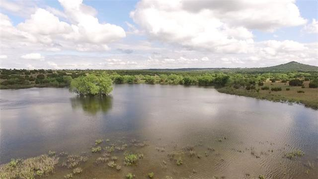 This property offers excellent hunting, fishing, grazing for livestock, rolling terrains with good tree coverage, and an spectacular building location with beautiful views. The special feature to this 281.70 acres is the 13 acre stock tank.With great fencing for livestock, cattle have been grazing this property for years. The windmill is a old Texas beauty site that houses a water well (unknown if working).Electricity near by.  Please check out the virtual tour provided by a professional videographer.