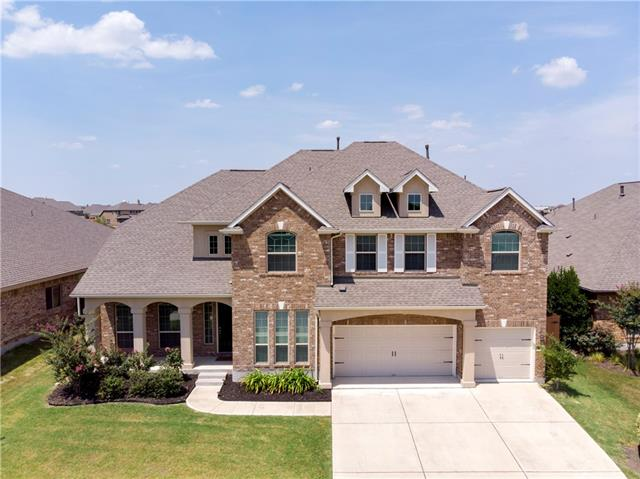 Beautiful family home that sits on an impressive view of mother nature.  This two story floorplan has all the features - Master Suite, Private Office, 2 Living, Dining on the first floor. Gameroom, bedrooms and additional study on 2nd floor. Main Living area features huge vaulted ceilings to take in the peaceful views. Beautiful eat-in kitchen with tons of cabinet space. Interior finishes include hardwood flooring throughout the first floor, upgraded granite, gas stove and stainless steel appliances.