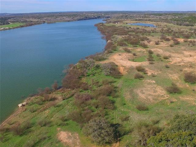 This picturesque ranch has it all.  From  breathtaking views to Lake Travis shoreline frontage, has all of the attributes that makes it one of the outstanding ranches for sale in the Highland Lakes/Hill Country of Texas. Whether the property is developed or kept intact,  buyers will have many options and opportunities with this w  Lake Travis frontage is approximately 1,900 feet.  This unique property is sprinkled with four   lakes/tanks, grandiose views.