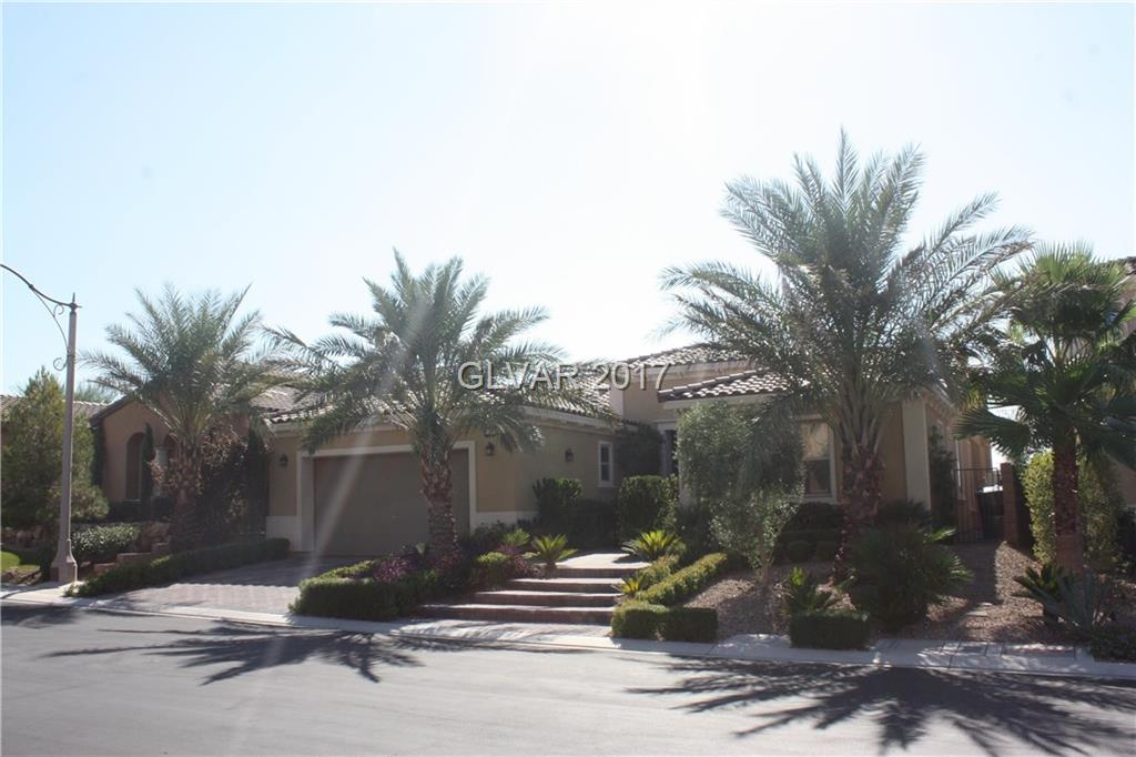 Beautiful single story home in Lake Las Vegas with the STRIP View!!!! Outdoor fireplace on covered patio. Green belt access from back yard. Beautiful home with upgraded flooring, upgraded cabinets, granite counters. surround sound theatre system.