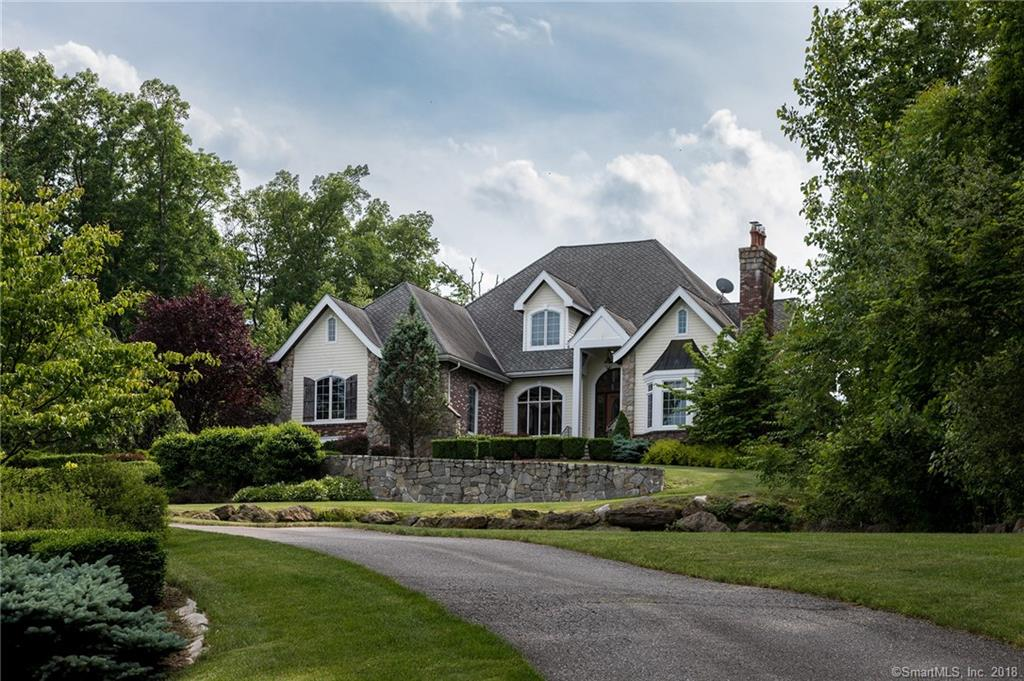 Gracious Traditional Home in stunning manicured setting with inground pool.