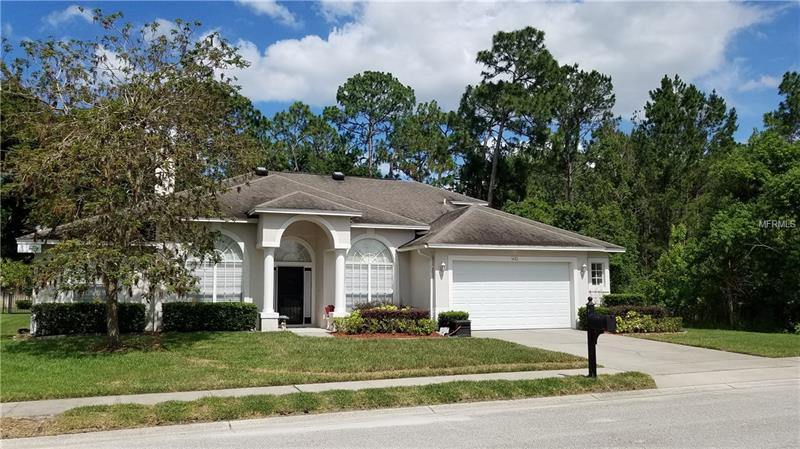 Look no more, this  well maintained home is being offered by the original owner.  Brand new Architectural shingle roof will be installed before closing!  This  4 to 5  bedroom/3 bath ( three way split plan) is great for the large family, extended family or couple that need space for hobbies.  The gated community gives added security and the lot is surrounded by natural woods and a conservation area with only one immediate neighbor.  This  pool home boasts a versitalle floor plan with soaring ceilings, open, with great views of the  pool from the family room, kitchen, breakfast room and master.    The family room has a wood burning fireplace, built in shelving, crown molding,  quality laminate wood floors, mitered glass window in breakfast room for optimal light and view.  The kitchen is appointed with  granite counter tops, 42 cabinets, stainless appliances, split plan, huge master suite and his and hers walk in closets. This inviting home has an oversized garage, inside utility room,  and large patio area overlooking the pool.  This home will not last, convenient to shopping, schools and parks.