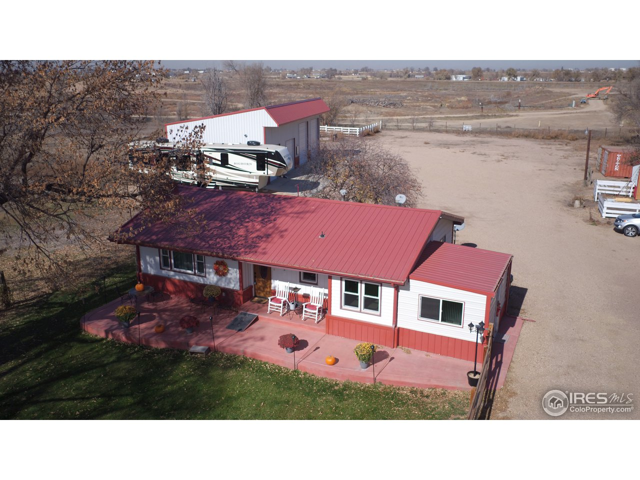 6 acres with a huge 1,920 sq foot shop right outside the city limits! This one of a kind property has several updates.  Sporting an incredible shop with rolling staircase, large hay shed, another storage area, new AC, new furnace, fence and much more. This comes with 1/3 water share for irrigation and has a ditch along the east edge of the property making for a very peaceful home. This really offers so much more that you must see!