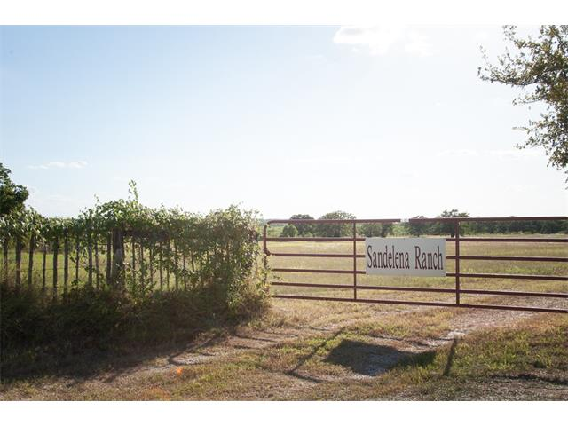 88.063 improved pasture with 3 ponds, beautiful grass, scattered trees, new fencing and a lovely 2009 Modular Home with 3 bedrooms, 2 baths, 1 large kitchen area that overlooks the family room. There is a divine covered front porch that overlooks this extraordinary property.