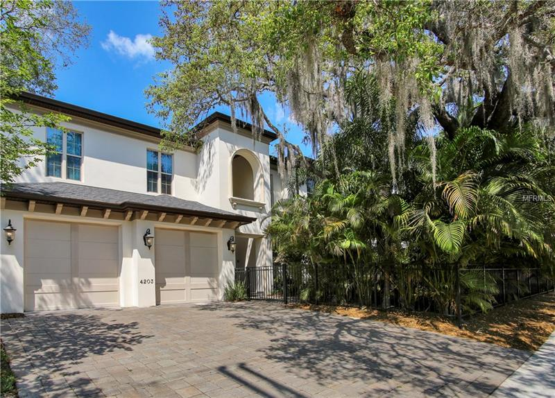 Absolutely STUNNING 6 bedroom, 6 (full) bath, 2- ½ bath, 7,200+ sq ft palatial home in South Tampa's Plant High School District must be seen to be appreciated.  Unassuming rare, treed, DOUBLE homesite is surrounded by bamboo offering tranquility in the heart of Beach Park.  Walk through the front door to find a 2-story foyer, guest suite, & formal dining room w/wetbar & wine fridge.  Further in, you will come to the spacious family room w/gas fireplace, casual eating area & beautiful kitchen w/granite counters, gas range & stone backsplash.  These rooms all boast wood floors. Past the family room is an ENORMOUS bonus/game room w/soaring 14' ceilings, natural-stained trim, bar for entertaining, & plenty of space for fun & games! Outside is the incredible free-form custom pool w/2-story screen, heated spa, & rock waterfall & grotto!  A spacious yard has ample possibilities for play and/or storage. Up the wood stairs you'll find volume ceilings, a wonderful loft surrounded by 5 bedrooms.  The master suite is part of the 2-story addition & offers extremely large spaces for the bedroom/sitting area, bathroom & closet! The 2nd master suite is also extremely large & has walk-in closets, garden tub, shower, and double vanities.  Each of the other guest bedrooms is in keeping w/the large spaces shown throughout the home. This home comes with a generator, pool heater, brick pavers, central vacuum, 3 A/C systems, tile roof, & so much more.  Priced-to-sell quickly, this home ready for new owners.