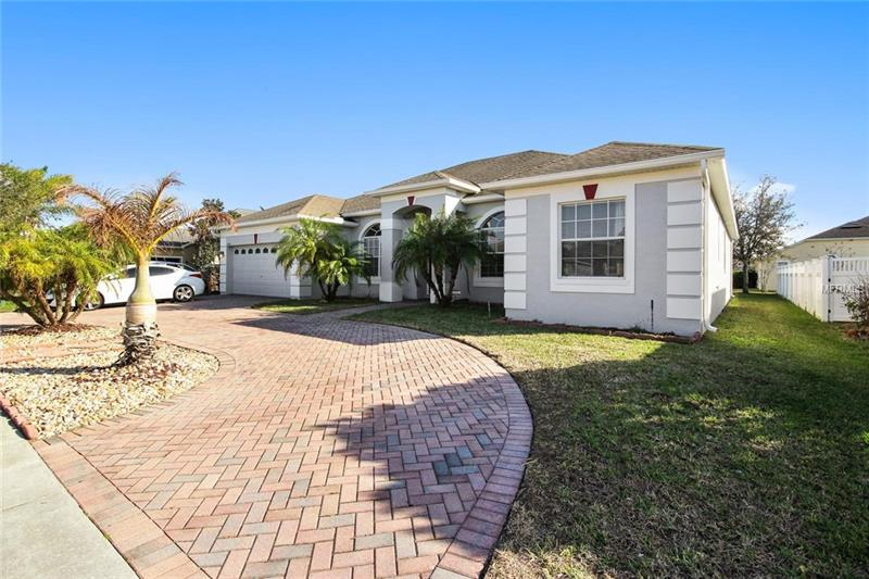 Look no further! Live a lifestyle of comfort, convenience and community in this newly updated single story home in the Cypress Lakes community. Desirable open floor plan features dramatic vaulted ceilings, **NEW A/C UNIT AND EXTERIOR PAINT (2018)**, and a neutral color palette. Open kitchen with breakfast nook overlooks family room with access to the covered lanai and private backyard. The family chef will love the UPDATED kitchen showcasing **STAINLESS STEEL APPLIANCES**, 42 inch cabinets, granite countertops, large walk-in pantry, and breakfast bar. Relax in the bright, open family room with **UPDATED EASY CARE TILE THROUGHOUT** and an abundance of natural light from the sliding doors leading to the backyard. 3-way split plan delivers a private extended master retreat with a large walk-in closet plus a master bath boasting dual sinks, garden tub, and a separate shower. The 4th bedroom sits separate from the other bedrooms - great for guest or a mother-in-law suite. The extended private backyard will quickly become your favorite place to sip your morning coffee or cookout with friends. Cypress Lakes offers a resort-style COMMUNITY POOL, tennis and basketball courts, splash pad, clubhouse with kitchen, fitness center, playground, walking trails, and a dog park. Nearby 408/ East-West Expressway provides an easy commute to the airport, downtown and to many attractions and Theme Parks. Don't miss the chance to make this beautiful home yours!