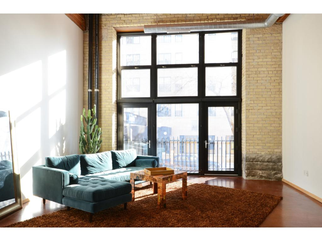 Historic River Park Lofts on Mears Park in Lowertown, on the skyway! First floor loft w/2nd level. 17' ceilings, wall of glass with Juliette balcony & screen doors. Exposed brick & beam, stained concrete flrs, granite tops, rare private bedroom on main flr. Short spiral stairs to master, custom walk-in closet, and 2nd full bath w/whirlpool.New tile both baths. Lowertown is one of America's most walkable communities! Farmer's Mkt, Mears Park, CHS Field, Union Depot, dining, river trails & more!